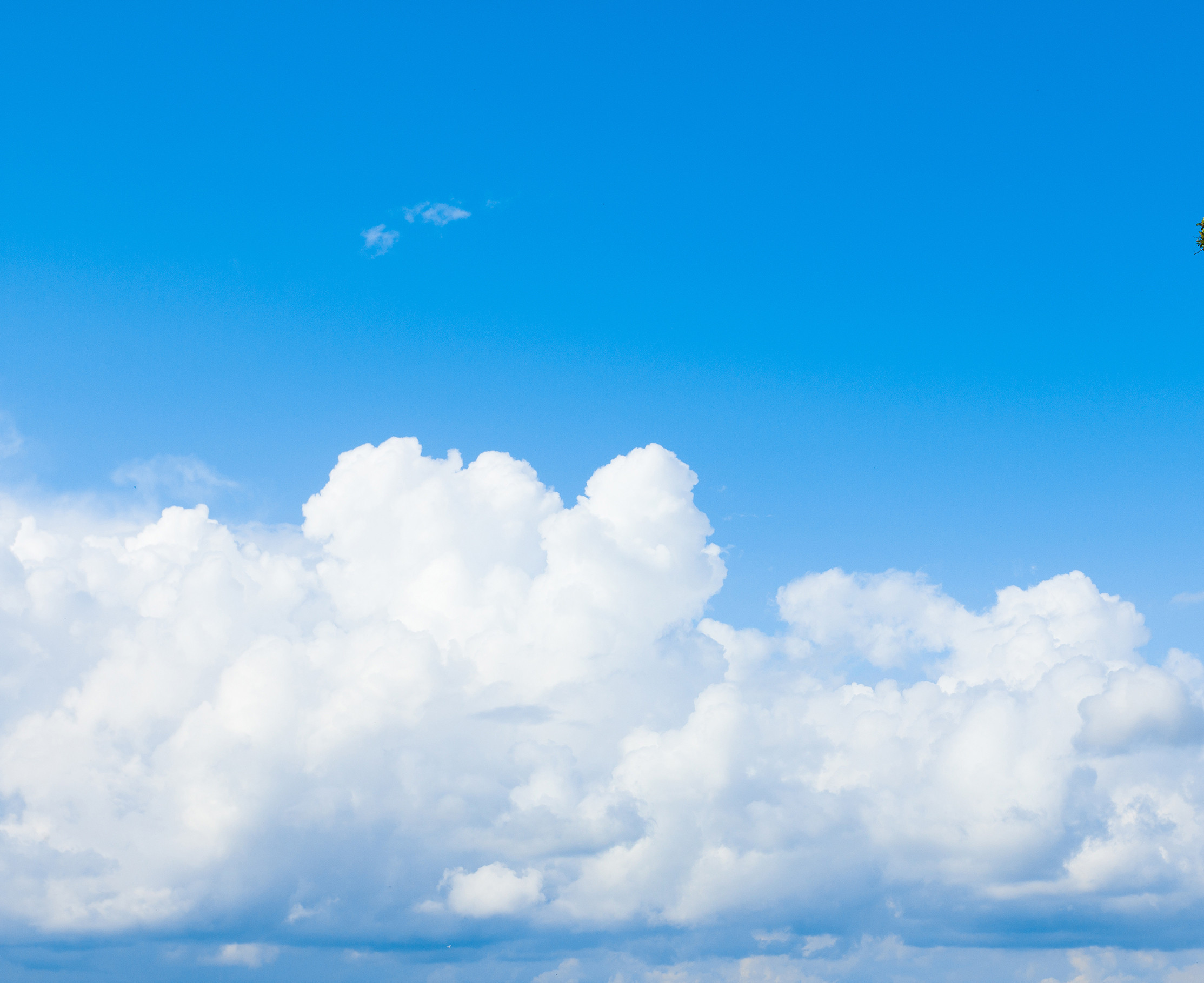 bigstock-Blue-Sunshine-Clouds-12729821