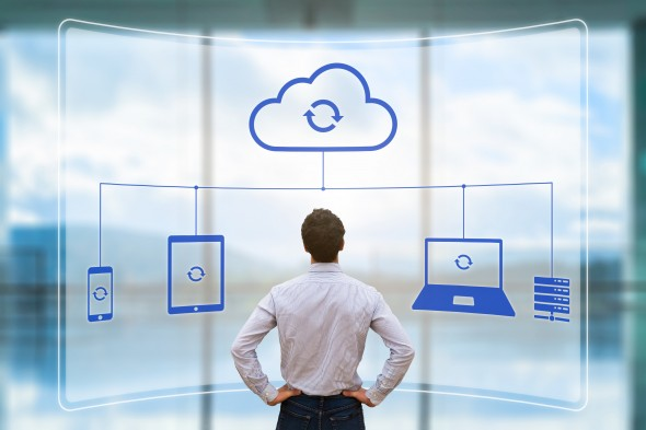 Cloud synchronizing between devices concept, virtual screen, syncing data, businessman